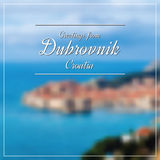 Greetings from Dubrovnik postcard with blurry image in back Stock Photos