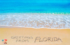 Greetings from FLorida written on a tropical beach Royalty Free Stock Photography