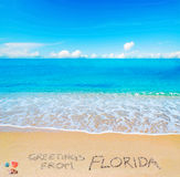 Greetings from FLorida written on a tropical beach Royalty Free Stock Photo