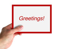 Greetings. Hand hold a big card with text Greetings. isolated on white royalty free illustration