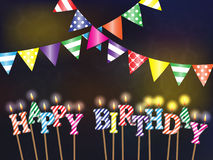 Greetings happy birthday with the lights and burning candles. On dark background Stock Photos