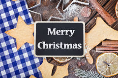 Greetings merry christmas and accessories for baking cookies Stock Photography