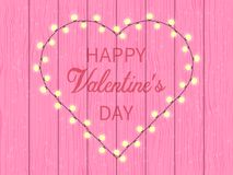 Greetings with Valentines day, pink wooden wall Stock Photo