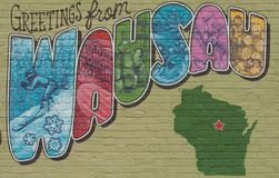 Postcard Mural of Wausau, Wisconsin. `Greetings from Wausau` postcard mural by artist Jessica Kopecky. Fours seasons and attractions  displayed in each letter Stock Photos