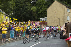 Greetland, England, JUL 06: The peloton riding up Hullen edge la Royalty Free Stock Images