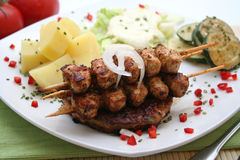 Greg food. A plate with greg food, meat and tzaziki royalty free stock image