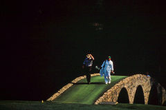 Greg Norman '99 Masters Championship. Golf Legend Greg Norman crosses the bridge at Augusta National Golf Course during the 1999 Masters Championship. (Image Royalty Free Stock Images