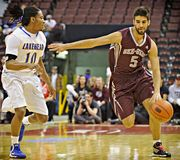 Men's CIS Basketball Finals. Gregg Cater (left) of the Lakehead Thunderwolves and Mehdi Tihani of the Ottawa Gee-Gees in action at Scotiabank Place, Ottawa on royalty free stock images