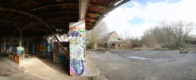 GREIFSWALD, GERMANY - FEBRUARY 29 2016 : Panoramic view of the entrance of abandoned building with graffiti Stock Photo