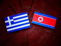 Grek flaga z koreańczyk z korei północnej flaga na drzewnym fiszorku Zdjęcia Stock