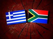 Grek flaga z południe - afrykanin flaga na drzewnym fiszorku odizolowywającym Obraz Stock