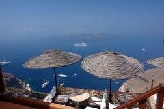 Grekisk balkong med paraplyer Royaltyfria Foton