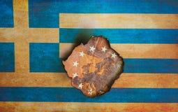 Grekisk flagga över det Europa begreppet royaltyfri fotografi