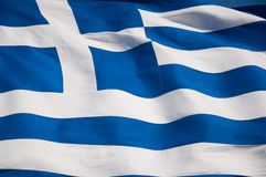 Grekisk flagga på akropolen av Aten, Grekland. Royaltyfri Bild