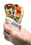 Grekisk pitabrödgyroskopsouvlaki i händerna Arkivfoto