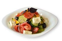 Grekisk sallad som isoleras på vit bakgrund Royaltyfria Foton