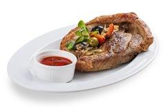 Grekisk stil för grisköttbiff arkivbild