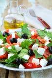 grekiska olivgrönsalladtomater Arkivbild
