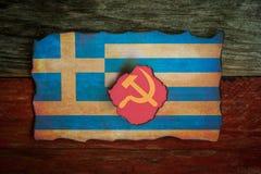 Grekiskt flaggakommunistbegrepp royaltyfri foto
