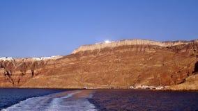 Grekland ön av den Santorini solnedgången Arkivbilder