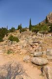 Grekland. Delphi. Forntida fördärvar arkivfoton