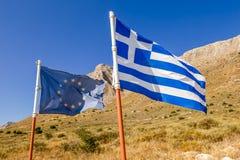 Grekland och Europa flaggor Arkivbilder