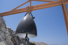 Grekland Symi en kyrklig klocka royaltyfria foton