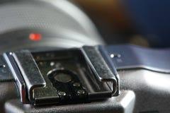 Grelles heißes Schuhteil der Kamera Stockfotografie
