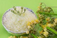 Gren bath salt on with linden flowers on a green backgound Stock Image