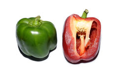 Gren pepper and red pepper cut Royalty Free Stock Photo
