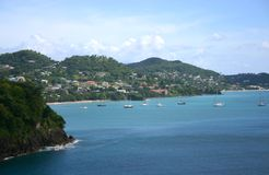 Grenada Coastline. Mountains rise up directly from the shore along the Grenada coast, boats in the water Stock Photography