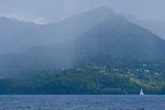 Grenada coastline in a rainstorm. Stock Image