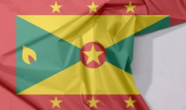 Grenada fabric flag crepe and crease with white space. Grenada fabric flag crepe and crease with white space, red border with six Gold star, Gold and green royalty free stock photo