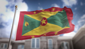 Grenada Flag 3D Rendering on Blue Sky Building Background Stock Images