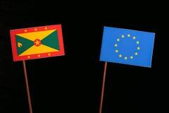 Grenada flag with European Union EU flag isolated on black. Background Stock Photos