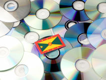 Grenada flag on top of CD and DVD pile isolated on white. Grenada flag on top of CD and DVD pile isolated Stock Images