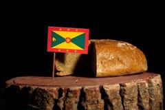 Grenada flaga na fiszorku z chlebem Fotografia Royalty Free