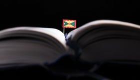 Grenada flaga po środku książki Obrazy Royalty Free
