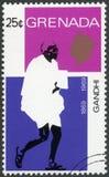 GRENADA - 1969: muestra el retrato de Mohandas Karamchand Gandhi 1869-1948, aniversario 100 años de Mahatma Gandhi, líder en la I Imagen de archivo libre de regalías