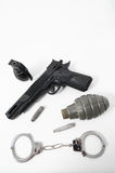 Grenade Bullets Gun and Handcuffs Stock Image