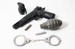 Grenade Bullets Gun and Handcuffs Royalty Free Stock Photos