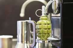 Grenade on a Coffee Machine Royalty Free Stock Image