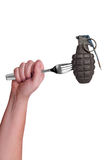 Grenade on fork Stock Photography