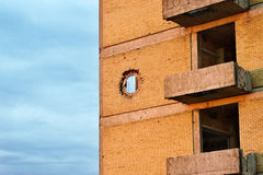 Grenade impact hole on the building Royalty Free Stock Photo
