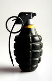 Grenade in profile. A fregmentation grenade under harsh side lighting to emphasise the shape and contours Stock Image