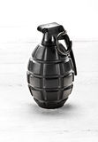 Grenade standing upright with the pin in Stock Photo