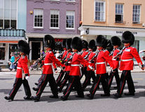Grenadier Guards marching through Windsor. The Grenadier Guards in Ceremonial Uniform marching through the Streets of Windsor after the Changing of the Guard Royalty Free Stock Image