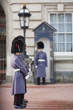 Grenadier guards wearing winter greatcoats Stock Photos