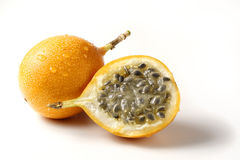 Grenadillas - passion fruit. A whole and a half grenadilla - passion fruit Stock Photo