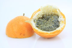 Grenadillas - passion fruit. A whole grenadilla cuted - passion fruit Royalty Free Stock Photo